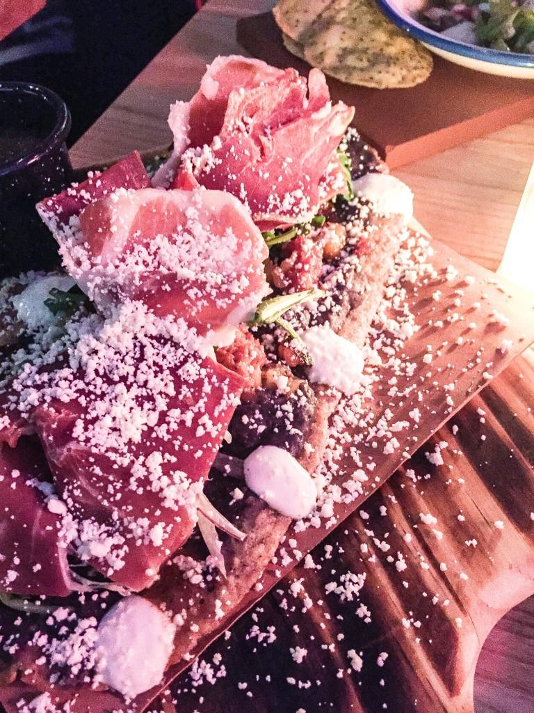 Huarache Chido - Grilled Corn huarache, potato chorizo hash, arugula, Serrano ham, salsa - $13