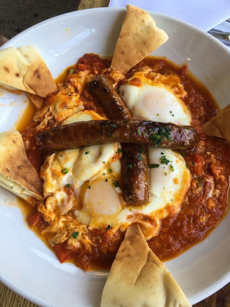 SHAKSHUKA MOROCCAN BREAKFAST three eggs baked with tomato, onion, pepper, spices, tahini, pita 14 add merguez sausage 5