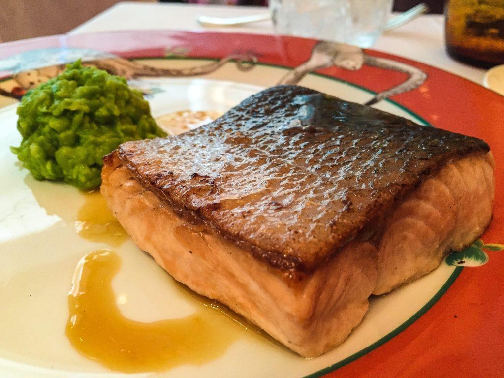 Salmon Green pea mash, orange and champagne dressing
