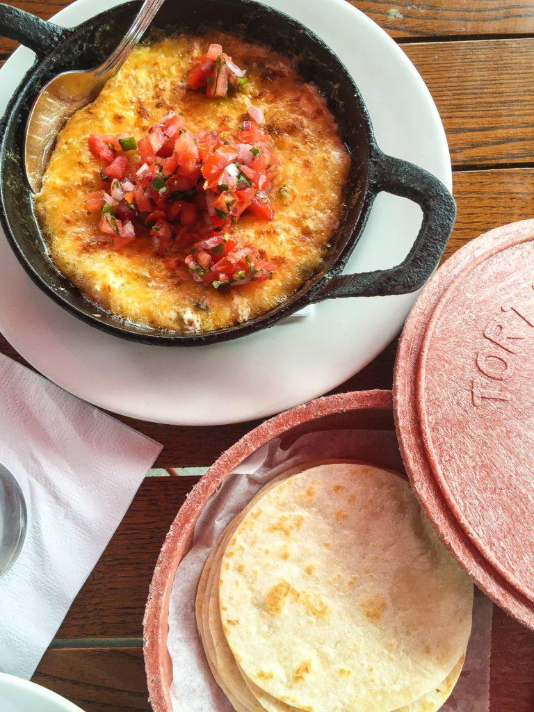 GREEN CHILE QUESO FUNDIDO  mexican cheese & green chile fondue, warm flour tortilla -  $12
