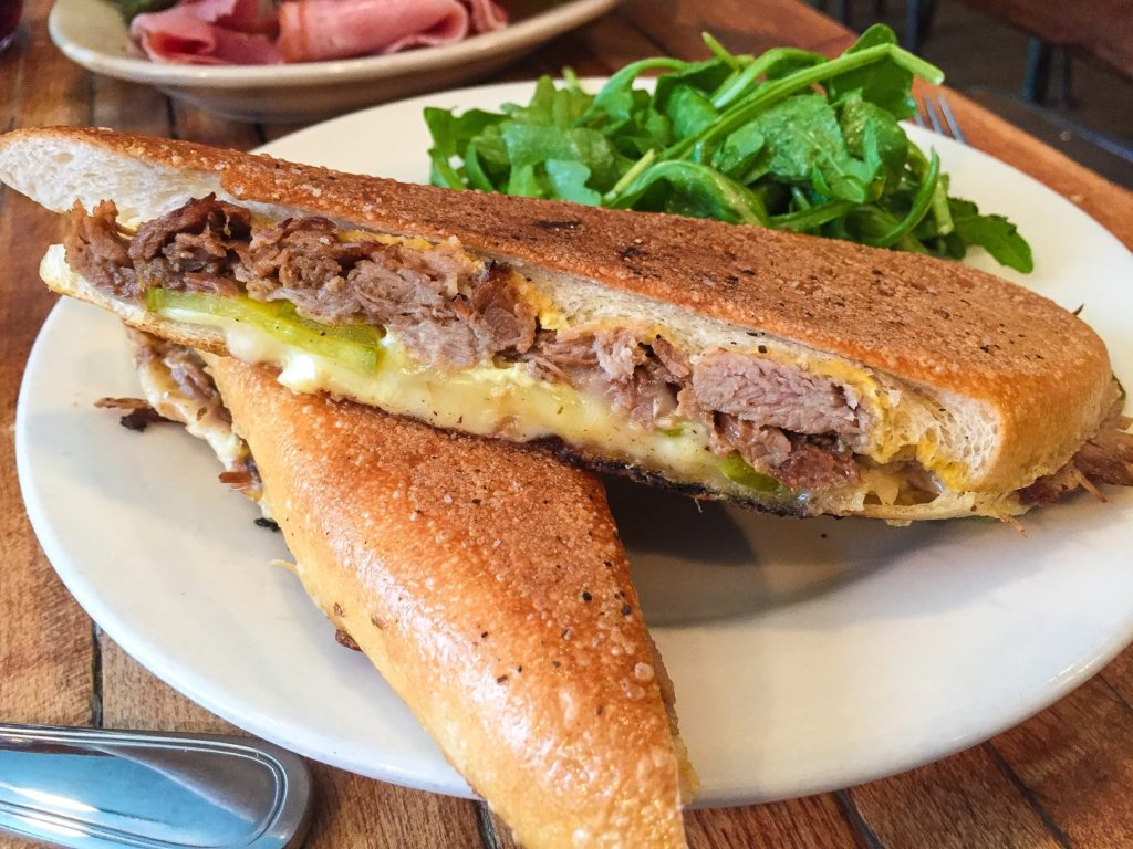 Havana   $11.00   Pulled pork, dijon mustard, housemade bread-and-butter pickles, & French raclette cheese on toasted Cuban roll